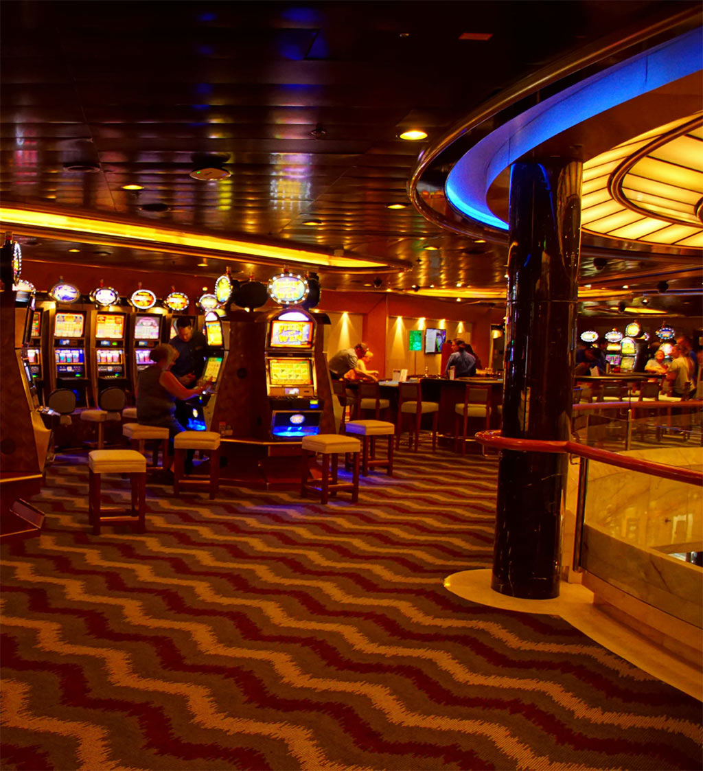 an image of a casino floor with lots of bright orange yellow and blue lights