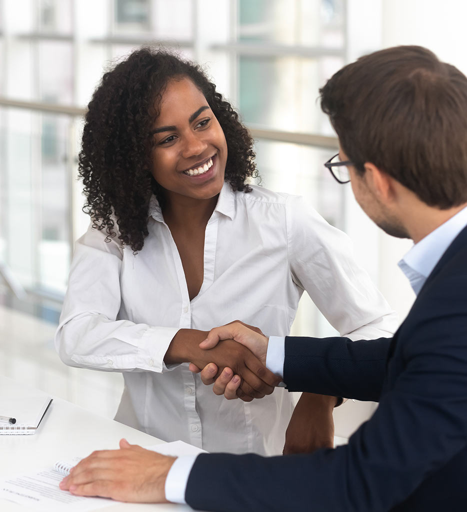 an image of a man and a woman meeting together and shaking hands in greeting
