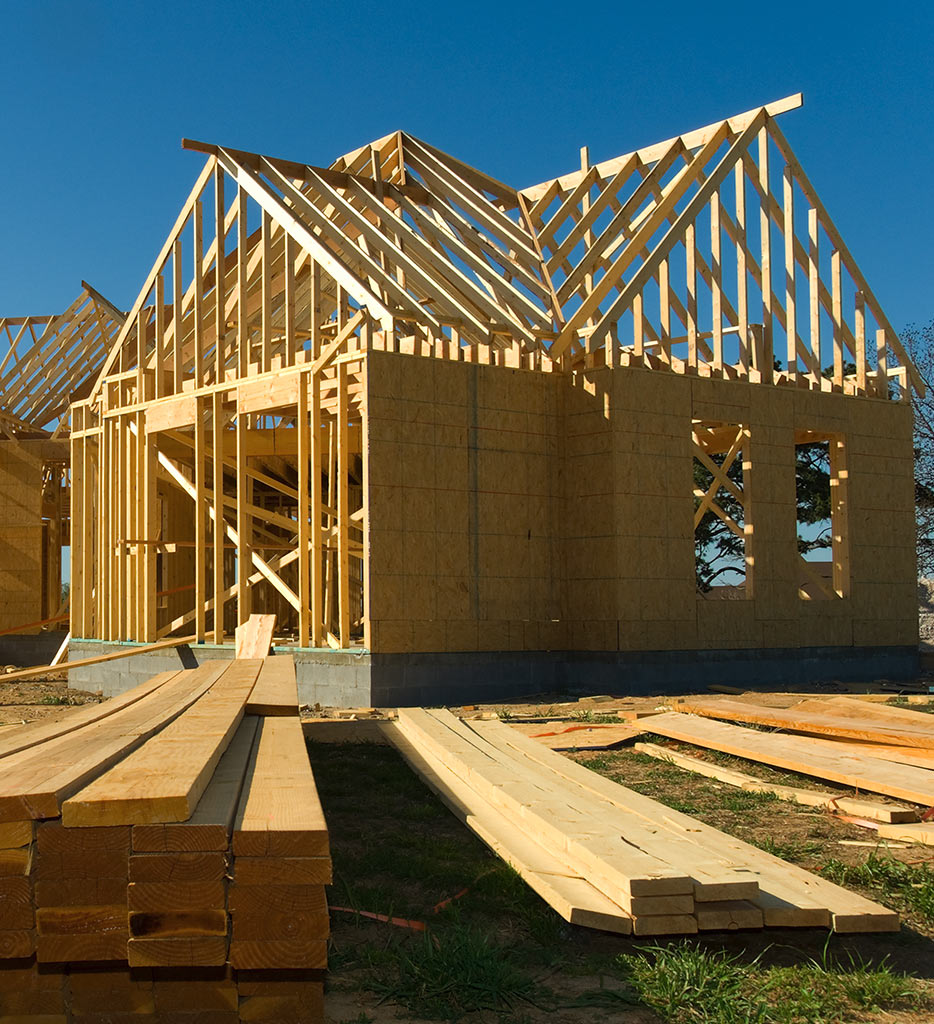 a frame of a house made of 2x4s on a concrete foundation